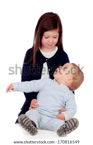 Loving girl taking care of her little brother isolated on a white background
