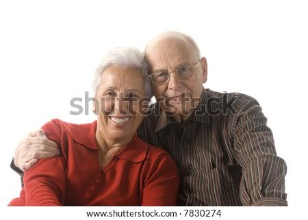 Loving, handsome senior couple on a white background - stock photo