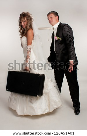 Loving happy newlyweds in studio - stock photo