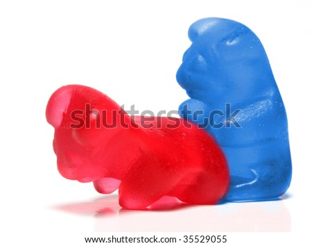 Loving jelly bears couple on a white background - conceptual image - on white background - stock photo
