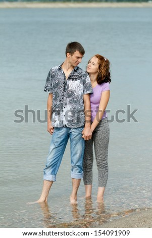 Loving man and woman in the sea water
