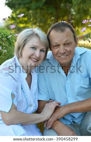Loving mature couple  in autumn  park on the Sunset - stock photo