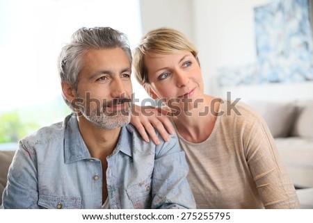 Loving mature couple looking towards the future - stock photo