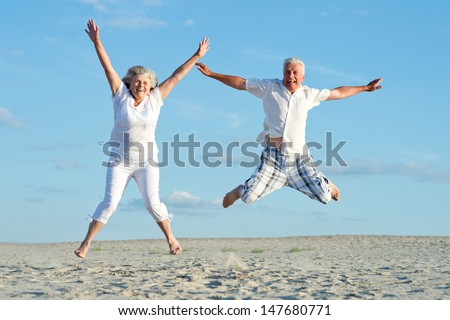 loving mature couple on a background of clear sky - stock photo