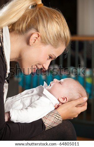 Loving moment between mother and her newborn son