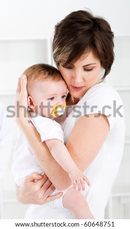 loving mother and baby girl at home - stock photo