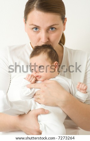 Loving mother cradling newborn baby in her arms - stock photo