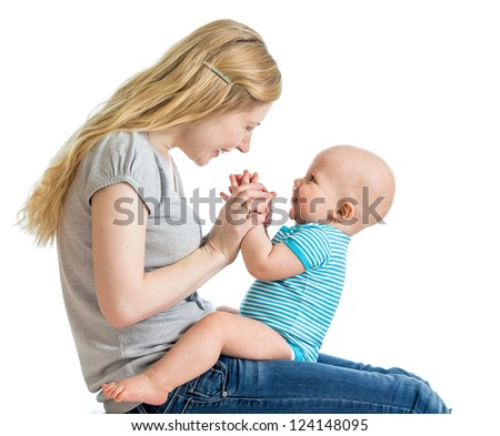 Loving mother having fun with her baby boy - stock photo