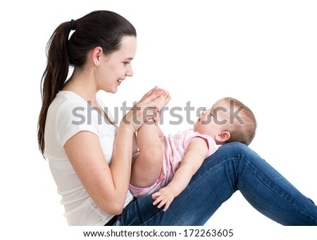 Loving mother having fun with her baby toddler - stock photo