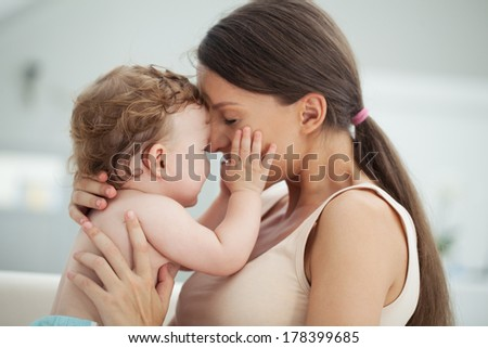 Loving mother playing with her baby boy. - stock photo