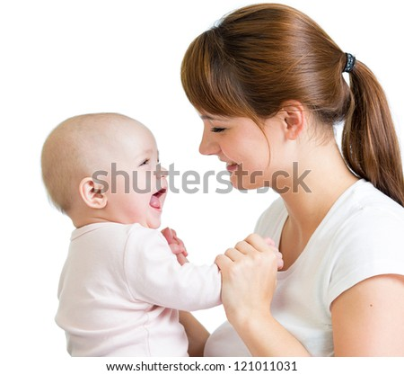 Loving mother playing with her baby on white background - stock photo