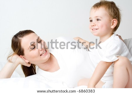 Loving mother with her young toddler son - stock photo
