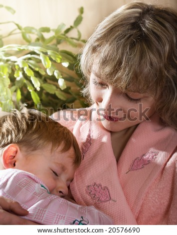 Loving mother with sleeping child - stock photo