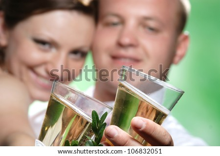 loving newlyweds with glasses of champagne - stock photo