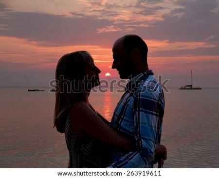 loving over a caribbean sunset - stock photo