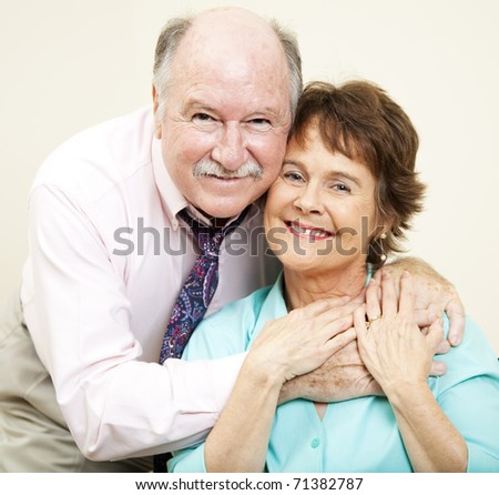 Loving portrait of good looking couple in their early sixties. - stock photo