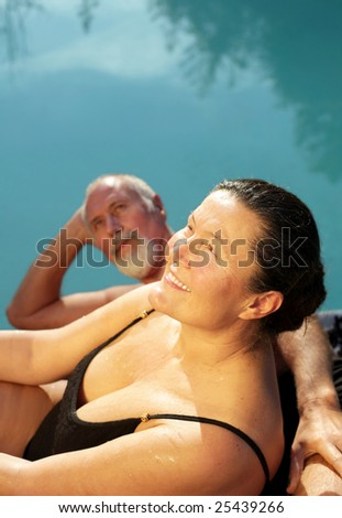 Loving senior couple having fun by the water - stock photo