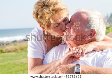 loving senior couple kissing - stock photo