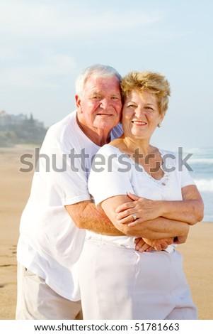 loving senior couple on beach - stock photo