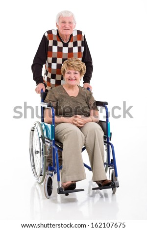 loving senior man with his disabled wife on white background - stock photo