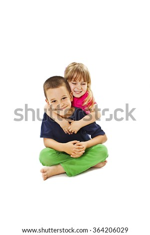 Loving sister and little brother hugging. Isolated on a white background - stock photo