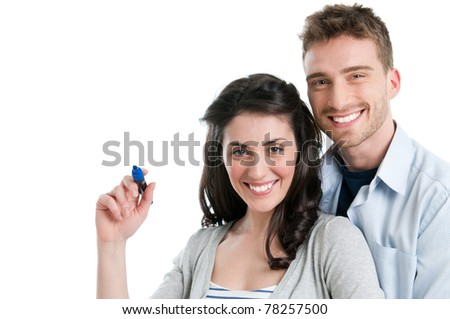 Loving smiling young couple write with marker your text isolated on white background - stock photo