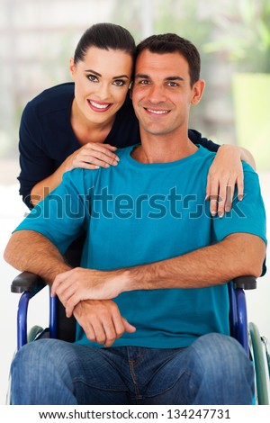 loving wife and handicapped husband at home - stock photo