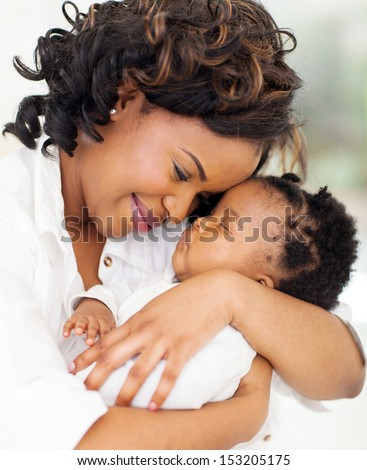 loving young african mother holding her asleep baby - stock photo