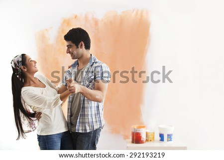 Loving young couple enjoying while dancing at home - stock photo