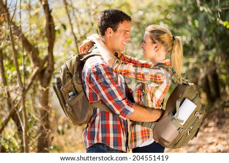 loving young couple hugging in autumn mountain