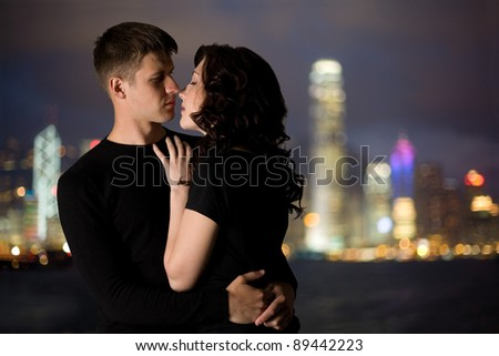 Loving young couple in the background of the Hong Kong. - stock photo