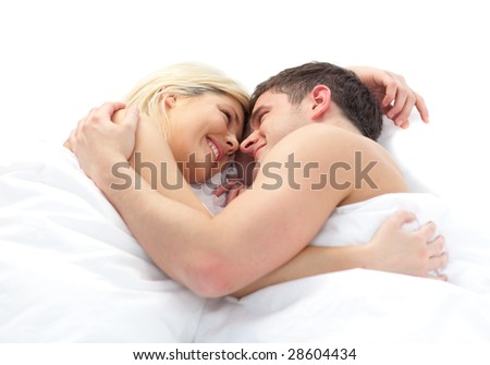 loving young Couple relaxing on bed - stock photo
