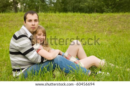Loving young couple resting  at the park - stock photo