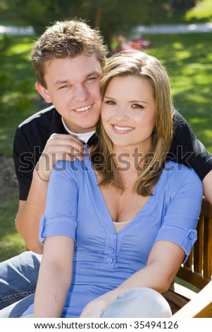 Loving young couple sitting on a bench