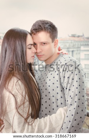 Loving young couple tenderly embracing touching foreheads and noses , Boyfriend and girlfriend in love hugging nose to nose - stock photo