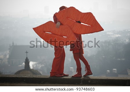 Loving young couple with symbol lips. - stock photo