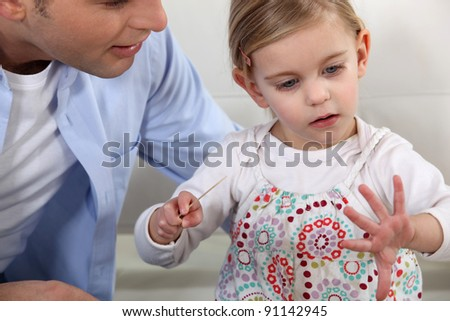 loving young father with young daughter - stock photo