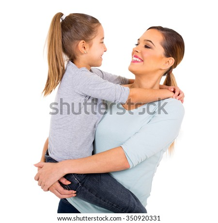 loving young mother holding her daughter on white background