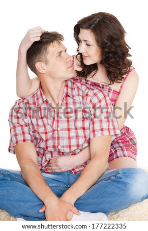 Loving young woman and a man looking at each other.  - stock photo