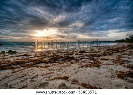 Low angle beach with sunset. - stock photo