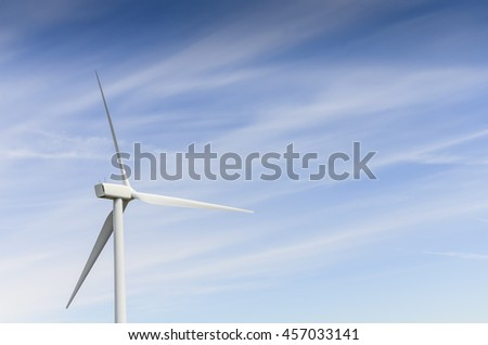 Low angle, close-up view a wind turbine tower again cloud blue sky on a wind farm at Ellensburg, Washington, US. Clean, sustainable, renewable energy concept. Alternative energy source from wind power - stock photo