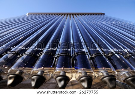 Low angle detail of evacuated tube solar collector - stock photo