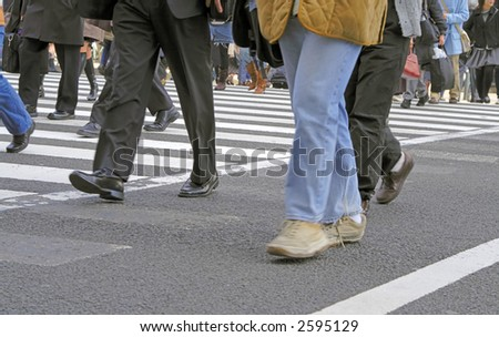 Low angle image of a people crowd crossing the street