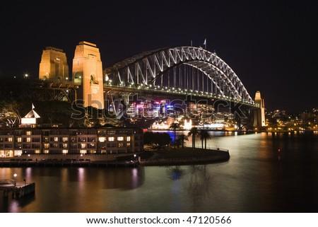 Low angle night view of Sydney Harbour Bridge in Austraila. Horizontal shot. - stock photo