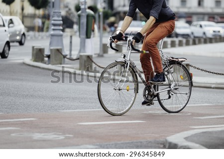 low angle of a casual man on bike  - stock photo