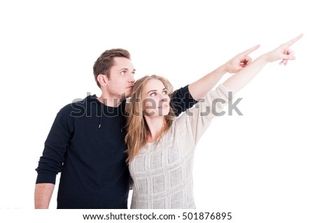 Low angle of couple pointing and wearing autumn clothes isolated on white background