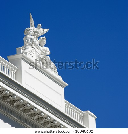 Low angle of statuary on the Sacramento Capitol building, California, USA. - stock photo