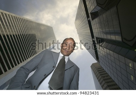 Low angle portrait of businessman looking down - stock photo