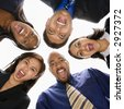 Low angle portrait  of multi-ethnic business group of men and women in huddle screaming. - stock photo
