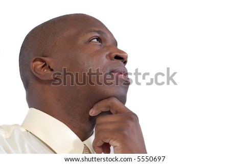 Low angle profile shot of a businessman concentrating on the matter at hand - stock photo